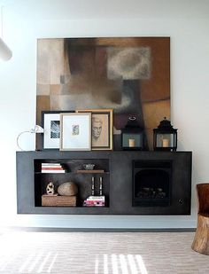A custom hot-rolled steel fireplace at a Chicago home by Kramer Design Studio