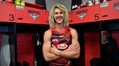 Boots 'n' all: there's no hiding Dyson Heppell's delight at being back in the Bombers locker room.Photo: Joe Armao