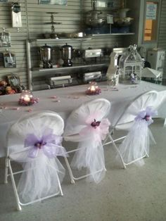 decorating a white folding chair for a wedding   CHAIR COVER DECORATIONS - Banquet Chairs