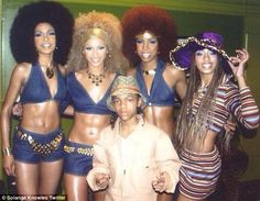 Bootilicious! Solange Knowles, right, posted this Throwback photo of her as a 14-year-old hanging out with big sister Beyonce and her Destiny's Child mates plus 'Lil Bow Wow before a gig in 2000