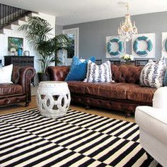 Color & Design Inspiration  Gray wall  Faux leather brown couches  Geometrical shape rug  accents of navy and lighter blue