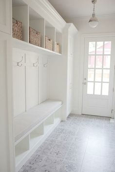 Mudroom with cement tile. White Mudroom with light grey cement tile. Everything … Mudroom with cement tile. White mudroom with light gray cement tile. Everything was perfectly designed in this mud room, but what really … Hall Deco, Home Renovation, Home Remodeling, Basement Renovations, Kitchen Remodeling, Mudroom Laundry Room, Mudroom Cubbies, Mudroom Cabinets, Mudroom Benches