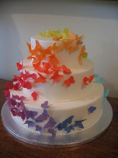 Rainbow butterfly cake - prob just one tier, with Rasta Coloured butterflies