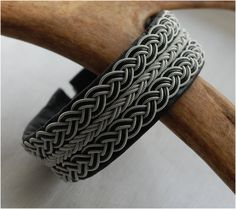Swedish Sami Bracelet of pewter thread with 4 % silver, and reindeer leather by SundesignSweden on Etsy
