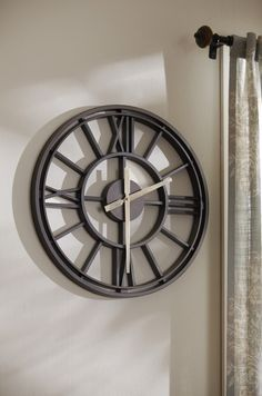 Make a big farmhouse statement in your home with an oversized metal wall clock. Click this pin to shop now!