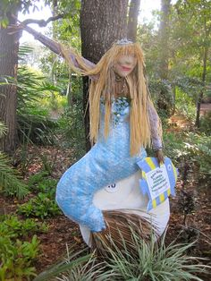 We created FFLora, the Florida-Friendly Landscaping mermaid scarecrow for the 2013 Scarecrow Contest at the Nature Coast Botanical Gardens in Spring Hill Florida. Scarecrow Festival, Scarecrow Crafts, Scarecrow Ideas, Spring Hill Florida, Scarecrows For Garden, Fall Yard Decor, Summer Fair, Trunk Or Treat, Happy Fall Y'all