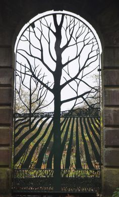 """This is a metal gate called, """"The Rabbit Gate - Norton Priory"""", but really should be done in stained leaded glass I think."""
