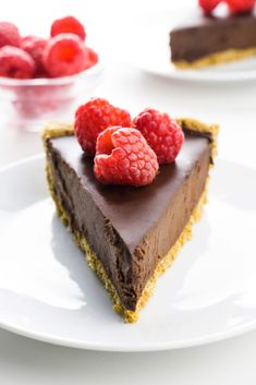 This dark chocolate pie features a rich, indulgent chocolate ganache filling in a simple oatmeal pie crust (or you can substitute your favorite homemade or storebought crust). It's made with a few ingredients and takes only a couple of steps. It's a favorite go-to dessert recipe! #darkchocoaltepie #veganchocolatepie #veganpie #namelymarly
