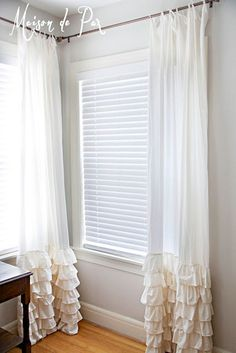 DIY Curtains: Give your curtains a touch of romance by adding feminine ruffles to the bottom. Plain muslin comes in very wide widths and is quite inexpensive. It's perfect for creating these flowing curtain panels. To keep the look soft, grosgrain ribbon has been used to hang the curtains. Ruffled Bottom Curtains Tutorial