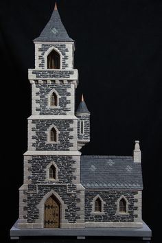 miniature stone lightehouse about 3 feet tall
