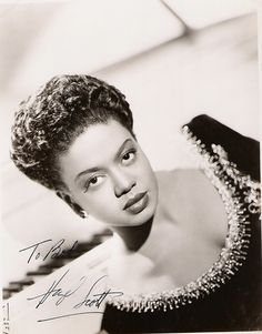 Hazel Scott - (1920-1981) Jazz Musician.  Born in Port of Spain, Trinidad, she began playing piano at the age of two. Hazel began formal music training after the family had moved to the United States in 1924 and recieved 6 scholarships to Julliard School of Music - which she had to turn down as she was only 14.  During the early 1950s, she became the first black woman to have her own television show, but due to accusations of being a communist; her show was canceled.