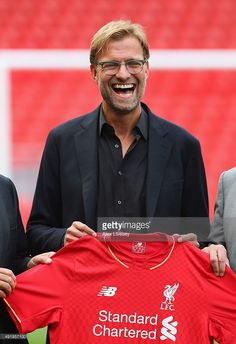 Jurgen Klopp is unveiled as the new manager of Liverpool FC during a press conference at Anfield on October 9, 2015 in Liverpool, England.