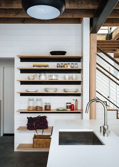 In a San Francisco renovation, open shelving offers an attractive way to organize and display plates and glassware. Photo by Joe Fletcher .