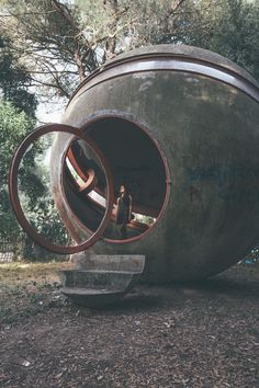An abandoned Brutalist structure, called Casa Sperimentale, outside of Rome. Photographed by Oliver Astrologo. This hollow concrete orb has red steel support for openings and concrete stairs.