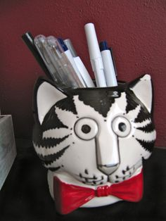 This Kliban Cat Mug makes a good pencil holder.