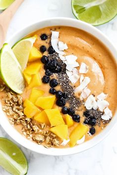 Fruity & sweet with a twist, this Mango Lime Smoothie Bowl is a great breakfast full of nutrition to keep you fueled during your day. Vegan & gluten-free! #emilieeats #veganrecipes #smoothiebowl #breakfast #healthyrecipes #veganbreakfast