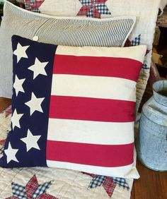 Proudly display you're a true-blue American with the American Flag Pillow! Toss it on your couch or chair in any room in the house - the patriotic theme fits wherever you put it! #patriotic #flag #pillows