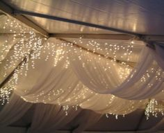 Ceiling swags with icicle lights. Very popular in the south. Beautiful for evening weddings/receptions