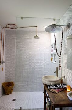 this is reverse of our bathroom. I like the tile and the shower. the vanity. need more storage.