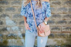 Show me your mumu off the shoulder top and distressed light jeans with lace up sandals and a nude crossbody. Spring & summer outfit inspiration from thesouthernstyleguide.com