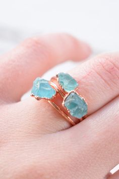 Rings as blue as the ocean.
