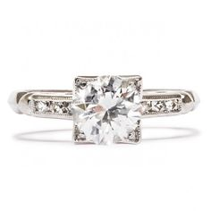 Woodbury is a classic Art Deco era vintage engagement ring featuring a 0.93ct Round Brilliant Cut diamond with F color in a crisp, angular setting. Love! TrumpetandHorn.com   $8,900