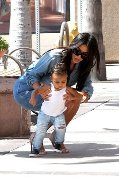 Toddling: Kim Kardashian's daughter North took some of her first steps on Wednesday as the family enjoyed an outing in La Jolla, California