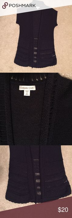 Sweater Vest Machine washable navy blue knit sweater vest.  This is in extremely great shape as I have never actually worn it. Cap sleeves, rolled collar and no buttons. Coldwater Creek Sweaters