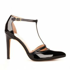 Almond toe t-strap heel with cutout detail and adjustable ankle strap.