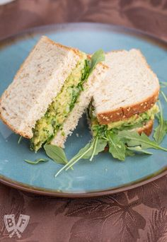 This Smashed Chickpea & Avocado Salad Sandwich is a fresh, hearty, healthy vegan lunch option that's guaranteed to please meat-eaters and vegetarians alike! It's a rich and creamy sandwich filling that you can feel good about eating!