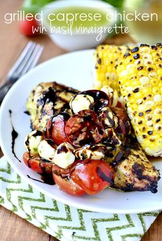 Gluten-free Grilled Caprese Chicken with Basil Vinaigrette uses the same basil vinaigrette for the chicken marinade and salad dressing. Fresh and so tasty! | http://iowagirleats.com