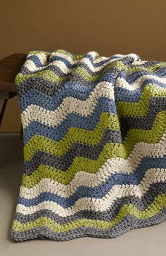 My mom crocheted me a chevron blanket for Christmas and I *heart* is so much I sleep with it every night :). Love this color combo too!  Lion brand free crochet pattern. Thick and quick #wool