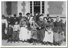 Immigrants Outside a Building on Ellis Island, early 20th century