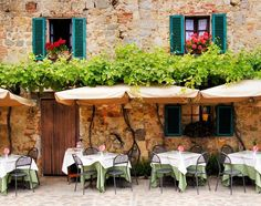 Picture of Cafe tables and chairs outside a quaint stone building in Tuscany, Italy stock photo, images and stock photography. Outdoor Cafe, Outdoor Decor, Outdoor Dining, Café Exterior, Italian Cafe, Italian Dining, Italian Dishes, Table Cafe, Camping