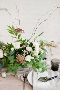 Earthy table setting with foraged wild flower arrangements // Organic contemporary winter wedding inspiration by Hey Look & Petra Veikkola, Finland