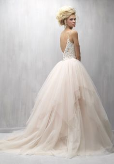 Featured Dress: Madison James; Extravagant blush tulle ballgown wedding dress idea.