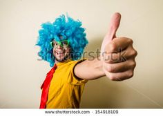 crazy funny young man with blue wig on white background by Eugenio Marongiu, via ShutterStock from $1