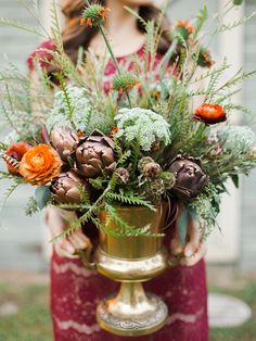 amazing floral arrangement // photo by Melanie Gabrielle // http://ruffledblog.com/woodsy-winter-dinner-party