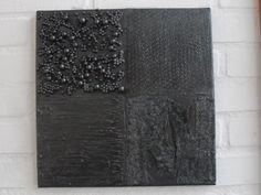 zwart, strak en met reliëf
