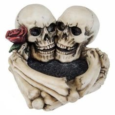Nemesis Now Last Tango Skeleton Ash Tray. Last Tango is a stunning ash tray of two skeleton skulls, with their boned arms holding each other and a rose. Last Tango Lovers Embrace, Last Tango, Wall Ornaments, Decoration, Heart Shapes, Gothic, Skulls, Skeletons, Frankenstein
