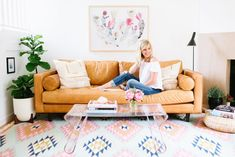 Glitter Guide founder Taylor Sterling at home in California with The Elodie Rug.