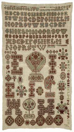 Merklap Maakster: E.I. Vervaardigingsdatum: 1703 Afmeting: 68.5 x 38.0 cm Plaats vervaardiging: Workum