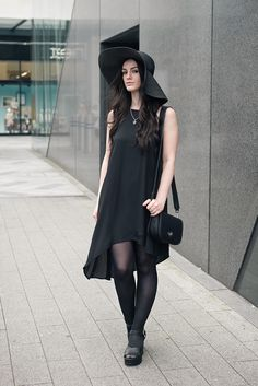 Fashion blogger Stephanie of FAIIINT wearing New Look black floppy strap hat, asymmetric cami dress & cleated platform sandals, Marc B Baby Bianca bag, Bloody Mary Metal tribal moon necklace & stack rings. All black everything street style summer goth outfit.
