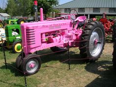 You won't miss this out working in a field!  Digging the John Deere PINK tractor.