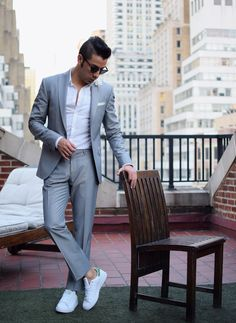 Shop this look on Lookastic:  http://lookastic.com/men/looks/lapel-pin-pocket-square-sunglasses-long-sleeve-shirt-suit-low-top-sneakers/10664  — White Floral Lapel Pin  — White Pocket Square  — Black Sunglasses  — White Long Sleeve Shirt  — Grey Suit  — White and Green Low Top Sneakers