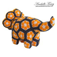 Meet Plod the triceratops. This triceratops is one of a kind and absolutely adorable doll. He is created by sewing 50 pieces of flower patches. He is made of premium acrylic yarn. Stuffed with polyester filling and has safety eyes. Plod is approximately 14 inches long and 8.5 inches