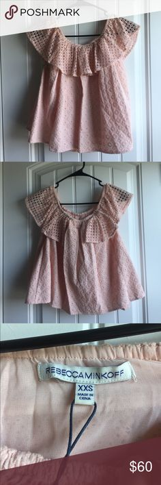 Rebecca Minkoff eyelet off-the-shoulder top Rebecca Minkoff Celestine Top. Off the shoulder top with inner liner in Pink Sand. Brand new, never worn, with tags. No trades or PP please. Smoke-free home. Rebecca Minkoff Tops