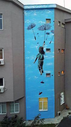 """""""Dandelion ride"""" Street art in Istanbul, Turkey, by artist ill. Photo by ill."""
