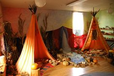 for the harvest...I love the cornstalks, dried gourds and teepee forts. Totally going to do this in (and out) of our preschool!