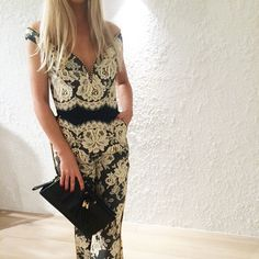 Ashley at Zimmermann Indooroopilly store wears Backbeat Lace Jumpsuit and Keltie Wristlet